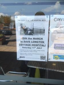 SLCH march poster in Blurton shop window